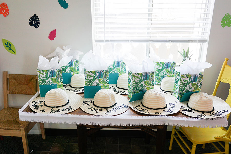 Easy beach bachelorette party ideas, including favors and hats!
