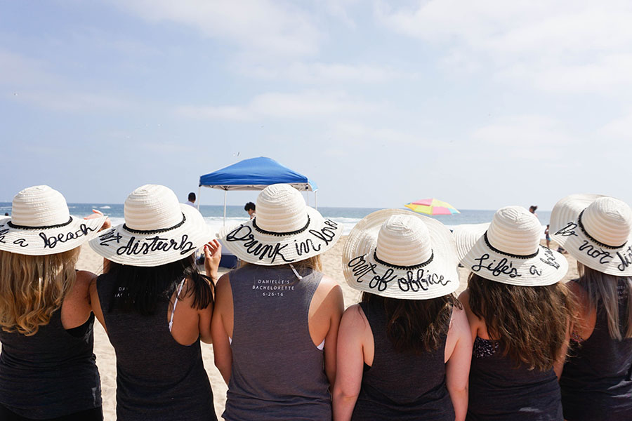 Make custom DIY hats for your bridesmaids -- they'll love you for it! Check out this beach bachelorette party for ideas!